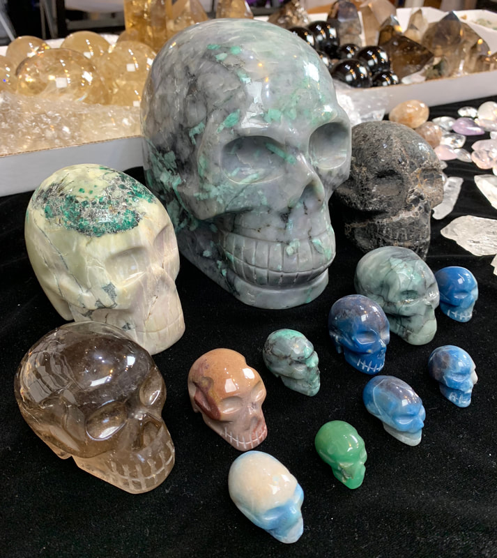 Citrine, Emerald, Black Tourmaline, and Lazulite Skulls.
